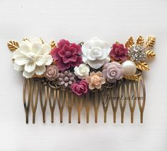 Maroon marsala red bridal comb with gold leaves, peppered with blush pink and mauve flowers. Romantic, elegant, unique wedding hair comb by Jewelsalem. Ideal ha