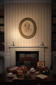 A portrait of Charlotte Bronte hangs above the fireplace in the dining room of the Bronte Parsonage Museum on February 2012 in Haworth, England. The famous Bronte sisters lived at Haworth.