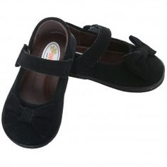 A sweet pair of dress shoes for your toddler girl from Angel Baby. These velvet slip on shoes feature a bow at the toe and strap with Velcro...