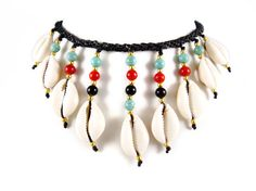 Extravagant, unique handmade thai micro macrame choker / collier - new 2014 design. Nine big, natural cowry shells are artfully integrated and adorned by turquoise, red howlite, black onyx and golden brass beads.