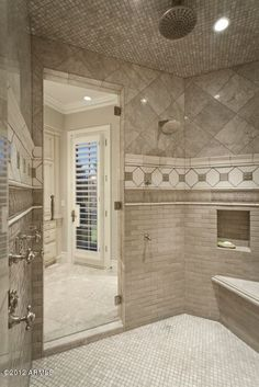 enormous walk-in shower with a pretty tile scheme...maybe add a bit of color and another storage inset