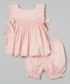 Look at this Pink Smocked Ruffle Top