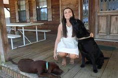 Family photo with Daisy the chocolate lab and Shadow the black lab!