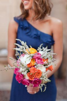 Blue bridesmaid's dress with multi-colored bouquet