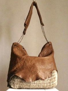 Raw edged leather over straw bag (or denim or...?) more finished look with chain and same leather strap