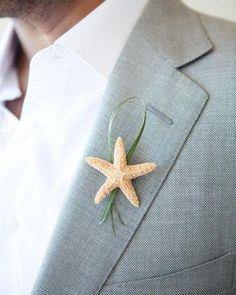 Instead of a flower, a starfish for a beach wedding! Cute Idea!
