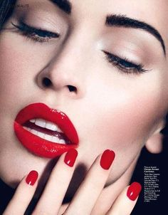 Love this cherry red lip and nail combination.  Her eyes are very natural. The colors compliment each other very well.