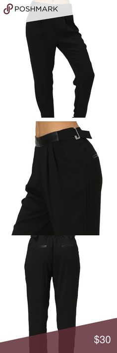 Black trousers with adjustable waste and pockets Cute black trousers. Faux leather waste with buckles on both sides to ensure great fit.  A zipper on one side and pockets on both sides.  Lightweight Material for comfortable and flexibility. Great for work or play. Offers accepted Pants Trousers