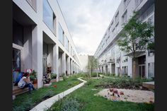 'An air of congenial chaos': while the dwellings provide opportunity for privacy, the shared green space is the social centre of the scheme