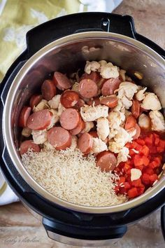 Ariel view of an open Instant Pot with cooked chicken and sausage, tomatoes, and rice for jambalaya.
