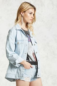 A denim jacket featuring a basic collar, button-front, long sleeves with buttoned cuffs, and dual buttoned flap chest pockets with dual slip pockets.