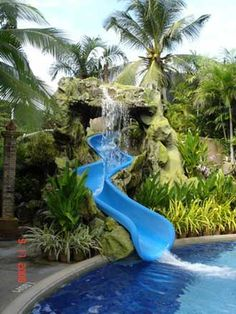 Swimming Pool Designs With Slides elaborate swimming pool featuring large grotto waterfall and tube slide nothing quite like a Great Pool Slides Safety Information Spectacular Swimming Pools Pinterest Swimming Pool Slides Pool Slides And Swimming Pools