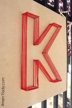 Large letter art ... nails and yarn.