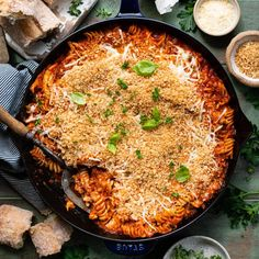 This quick and easy Chicken Parmesan Casserole is a cozy, family-friendly dinner that comes together with very little effort. Stir together shredded rotisserie chicken, tender pasta, store-bought marinara sauce and plenty of cheese, then top with toasted garlic butter Panko bread crumbs. The baked Chicken Parmesan Casserole is a delicious weeknight meal when served alongside a simple green salad and a loaf of crusty bread! This shredded Chicken Parmesan Casserole is such a fun and easy twist…