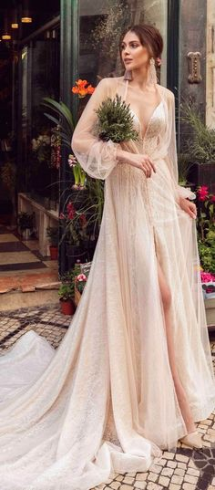Long sleeves plunging neckline embellishment a line wedding dress : Innocentia #wedding #weddingdress #weddinggown #bridalgown