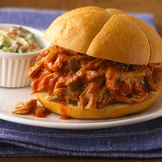 Slow Cooker Pulled Chicken Sandwiches... A no-fuss, savory slow cooker pulled chicken sandwich recipe flavored with Manwich, onion and pickled jalapeno that takes just 15 minutes to prepare