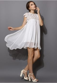 Swing White Dress with Lace Top. Would like under lining to be longer but the dress is lovely.
