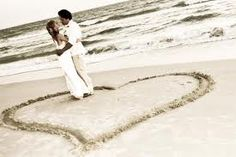 couple in a heart on the beach