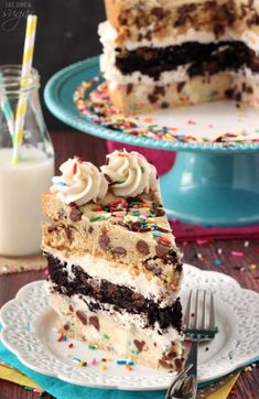 The Ultimate Layered Chocolate Chip Cookie Cake - a layer of traditional chocolate chip cookie, all chocolate cookie and funfetti cake batter cookie! The best way to eat cookie cake!