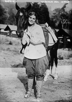 This Los Angeles mail carrier must have broken a lot of hearts along her postal route. She's beautiful! From the 1910s. (Bizarre Los Angeles)
