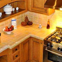 Kitchen cabinets and tile countertop