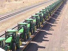 Tractor Train pictures   These  are pictures of 131 JD Tractors being shipped from the John Deere Waterloo Works  to China. They left Waterloo and went to the port of Tacoma. It took 49  rail cars to haul them. An amazing site across Central Nebraska....a near 50 car Union Pacific Train, consisting solely of Waterloo John Deere tractors, passed ...