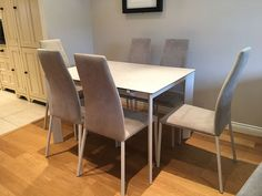Link extendable ceramic top dining table with Vita dining chairs. Delivered to our client in Surrey.
