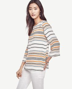 """In+fluid+crepe,+our+artfully+striped+top+wakes+up+your+winter+wardrobe+with+fresh+hues+-+and+a+flattering+fit.+Boatneck.+3/4+sleeves.+Side+slits.+24+3/4""""+long."""