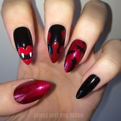 Red and black stiletto nails. Glittery red, vampire teeth, blood drip, and bats. #halloween #nailart