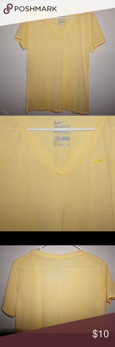 The Nike Tee in yellow. Size L. Never worn. Cute thinly striped v-neck workout shirt by Nike. In yellow and size L. Never worn. Nike Tops Tees - Short Sleeve