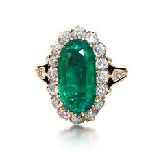 An Antique Emerald and Diamond Cluster Ring, Circa 1890