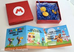 Super Mario Invitations boxed up with gold coin chocolates.