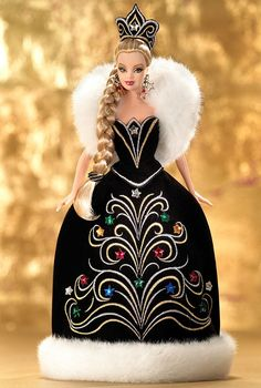 Release date: 6/1/2006  product code:J0949  The 2006 Holiday™ Barbie® by Bob Mackie is wonderfully sophisticated in a black gown and white faux fur, embellished with festive multicolored stars. 2006 Holiday™ Barbie® marks Mr. Mackie's second Holiday™ Barbie® doll creation, sure to be treasured for years to come.