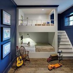 White and Navy Bunk Room with Built In Staircase