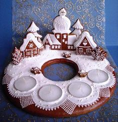 Gingerbread village with advent candles Gingerbread Village, Christmas Gingerbread House, Noel Christmas, Christmas Goodies, Gingerbread Man, Christmas Baking, All Things Christmas, Gingerbread Cookies, Christmas Crafts