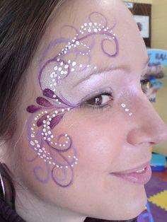 Beautiful eye face paint in purples