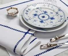 Julia B. Vannes custom napkins and placemats pair so well with classic blue and white china and silver