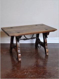 Antique Spanish Walnut Castellana Table with Iron Stretcher Traditional table style from Granada Dimensions: x x