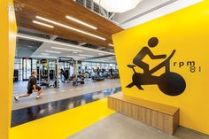 Gensler San Jose's Fitness Center for Symantec | A vinyl pictograph indicates the spin room. #design #interiordesign #interiordesignmagazine #fitness