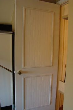 DIY- redo ugly doors with beadboard wallpaper
