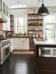 Wood shelves, wood/brown counters, white cabinets and door style, dark hardware, dark floor, stainless appliances and range hood.