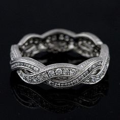 Diamond Eternity Infinity Pave Channel Wedding Band Engraved Sides 18K White Gold 4.3mm Wide by OroSpot on Etsy https://www.etsy.com/listing/124499768/diamond-eternity-infinity-pave-channel