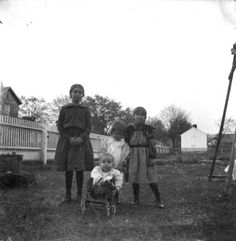 Four children in the yard of a house in Montevallo, Alabama. :: Alabama Photographs and Pictures Collection