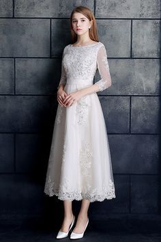 Shop low price vintage tea length lace tulle a-line white wedding dress 3/4 sleeve online. Custom-made any size or color. Pro since 2009.