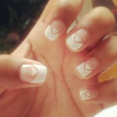 A cute looking French manicure ensemble, the nails use a clear polish as base then coated on top is a thick layer of white polish for the French tips. An additional cute heart shaped polish is also coated in between the v-shaped French tips.