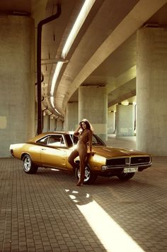 1969 Dodge Charger Probably one of my all time favorites. The girl is actually ruining this picture imo. Is that a factory color?