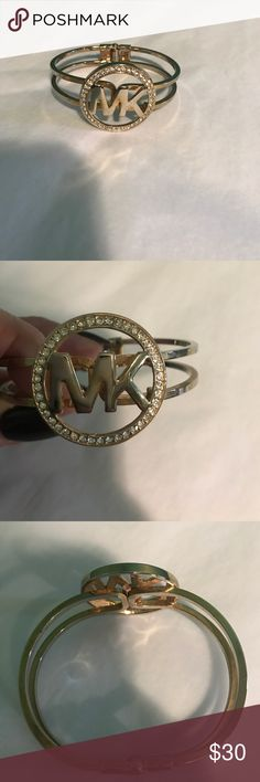 Michael kors gold hinged bling detail bracelet Michael Kors gold time hinged bracelet. It has the MK logo circled by crystals. Perfect condition Michael Kors Jewelry Bracelets