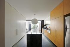Looking along the length of the kitchen toward the entry courtyard.