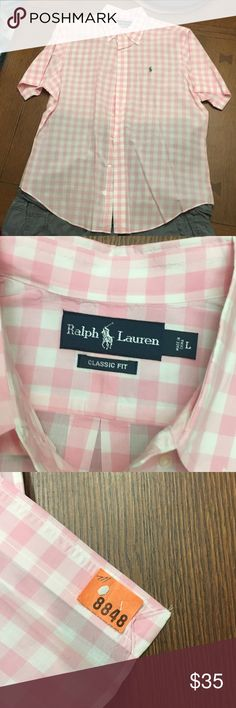 NWOT Ralph Lauren Classic Fit Button Up NWOT Ralph Lauren Classic Fit Short Sleeve Button Up. The shirt was bought, taken to the cleaners and never worn. BUNDLE & Get 15% discount. Ralph Lauren Tops Button Down Shirts