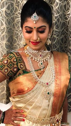 Manasa looks ethereal for her muhurtham! Hair and makeup by Vejetha for Swank. Indian bridal makeup. Bridal MUA. South Indian bride. Red lips. Bridal diamond jewellery. Silk saree. Saree blouse design. Eye makeup on fleek. Bridal hair.